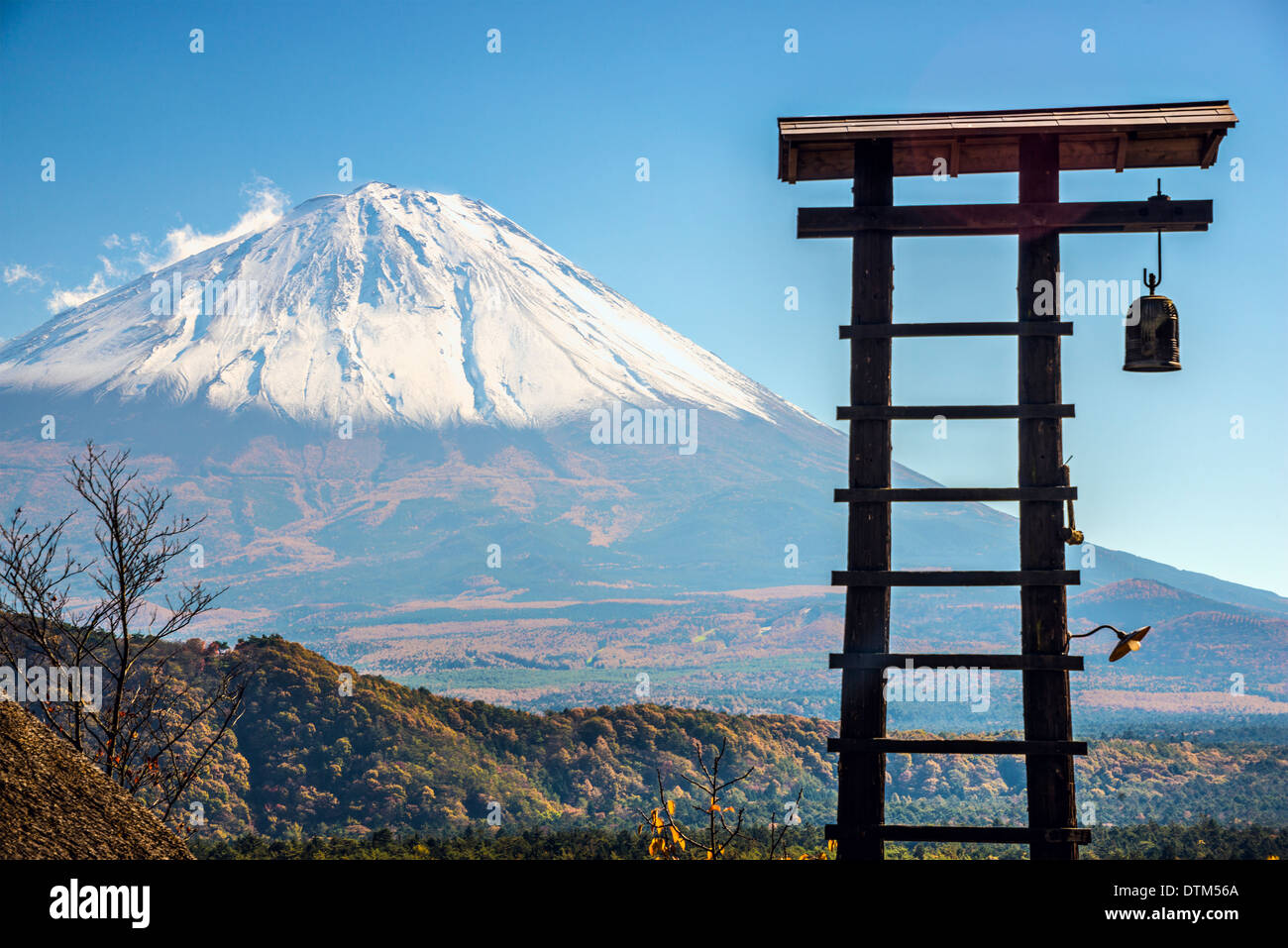 Fuji Mountain and an old village bell tower in Japan. - Stock Image