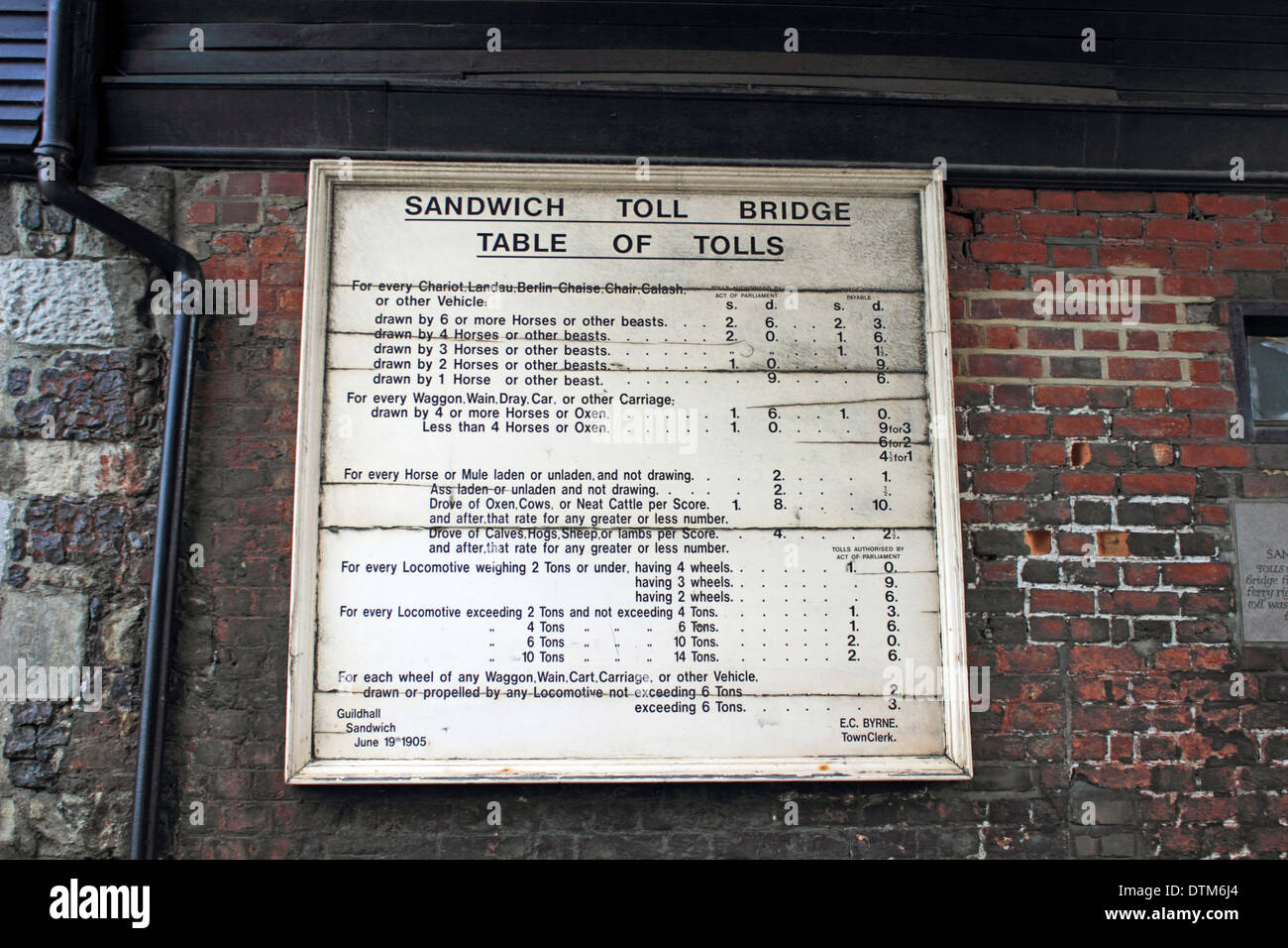 The table of tolls at the Toll Bridge in historic town of Sandwich, Kent, England, UK. - Stock Image