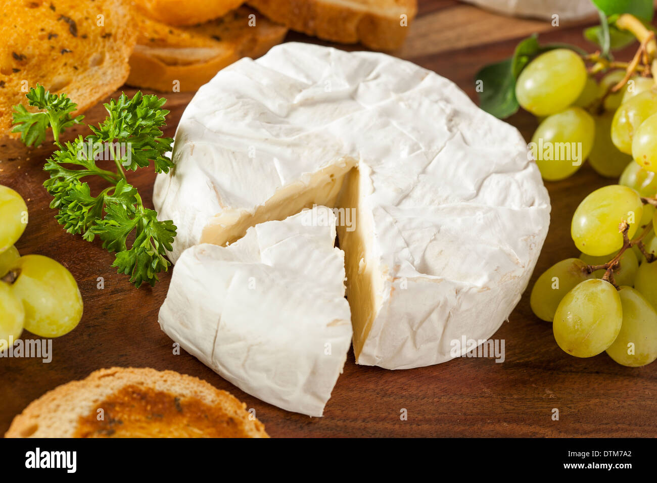 Organic Homemade White Brie Cheese with Bread and Grapes - Stock Image