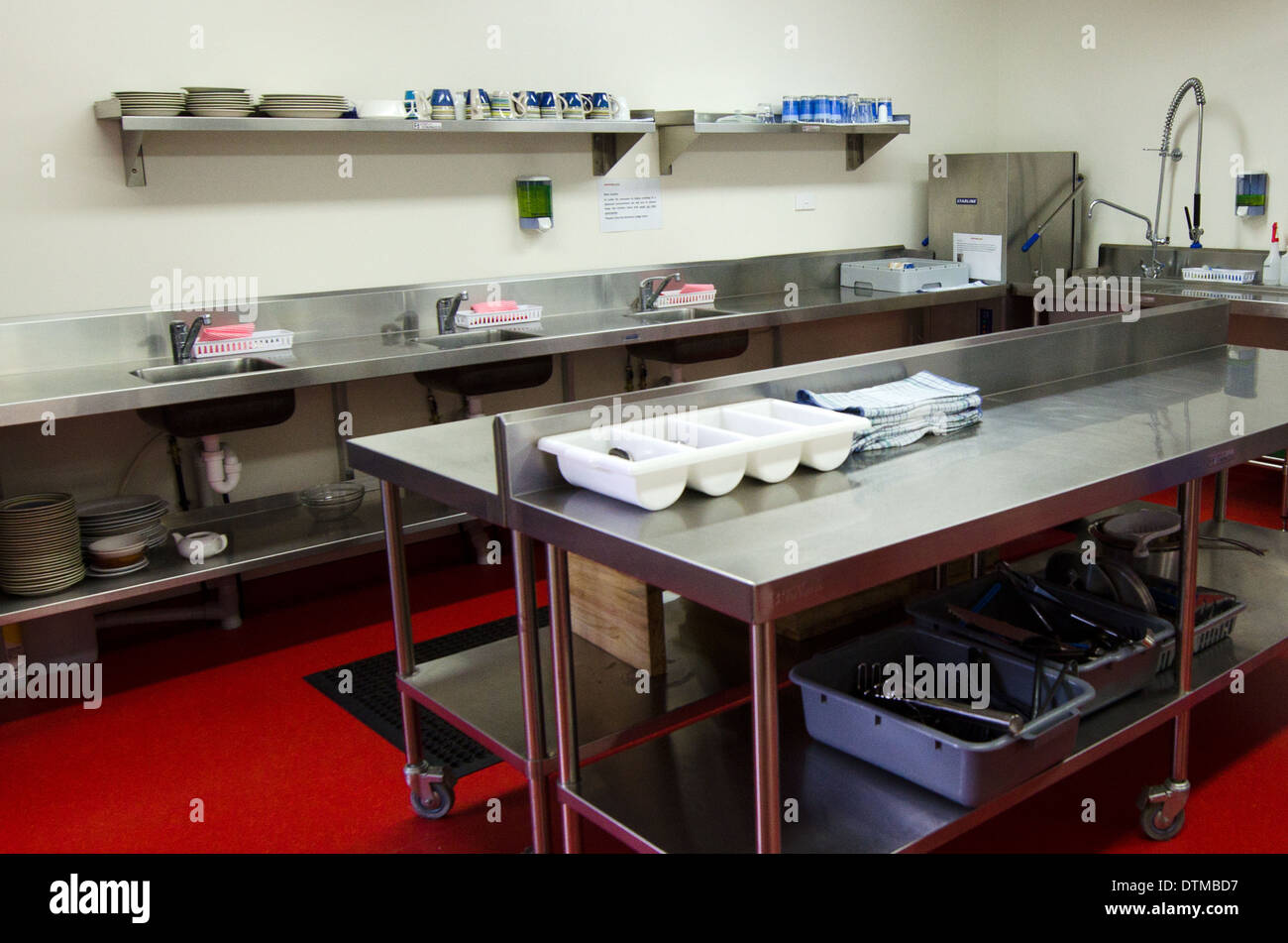 Work surface and kitchen equipment in professional kitchen - Stock Image