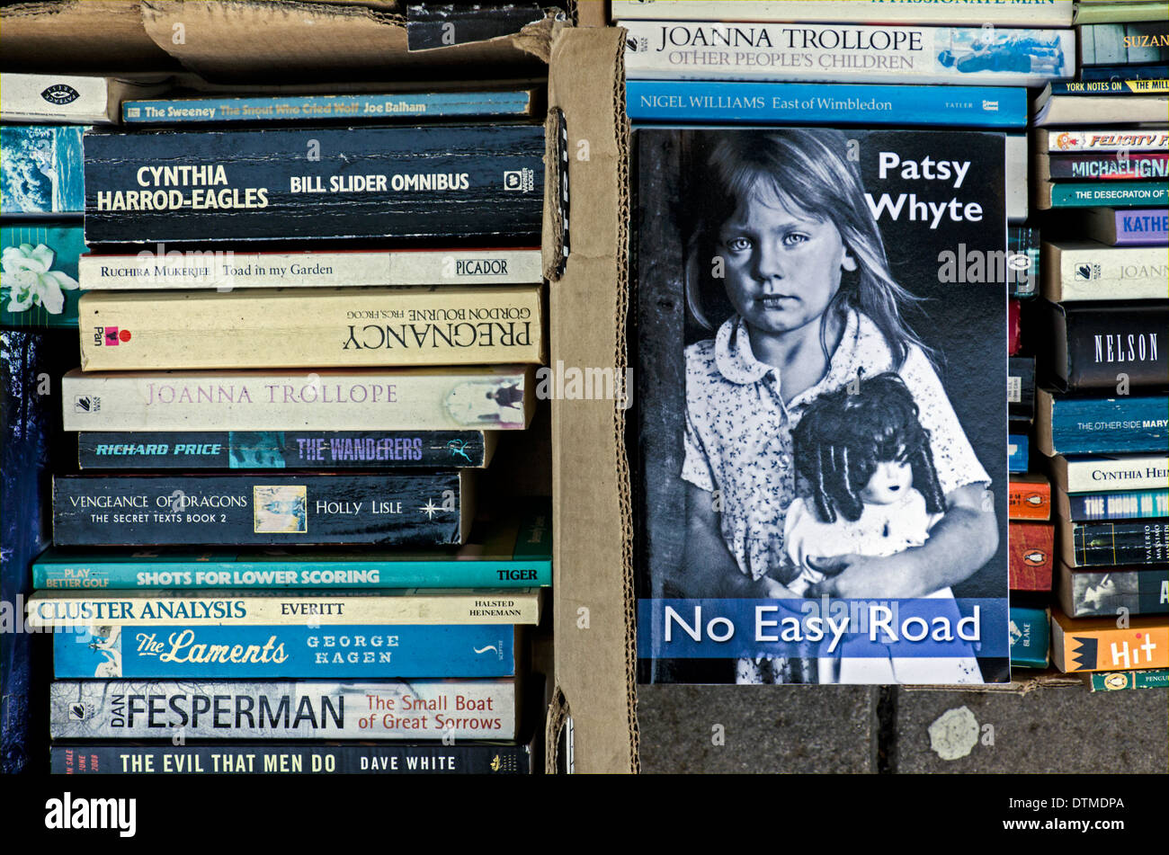 Boxes of secondhand paperback books outside a shop in Edinburgh, Scotland, UK. - Stock Image
