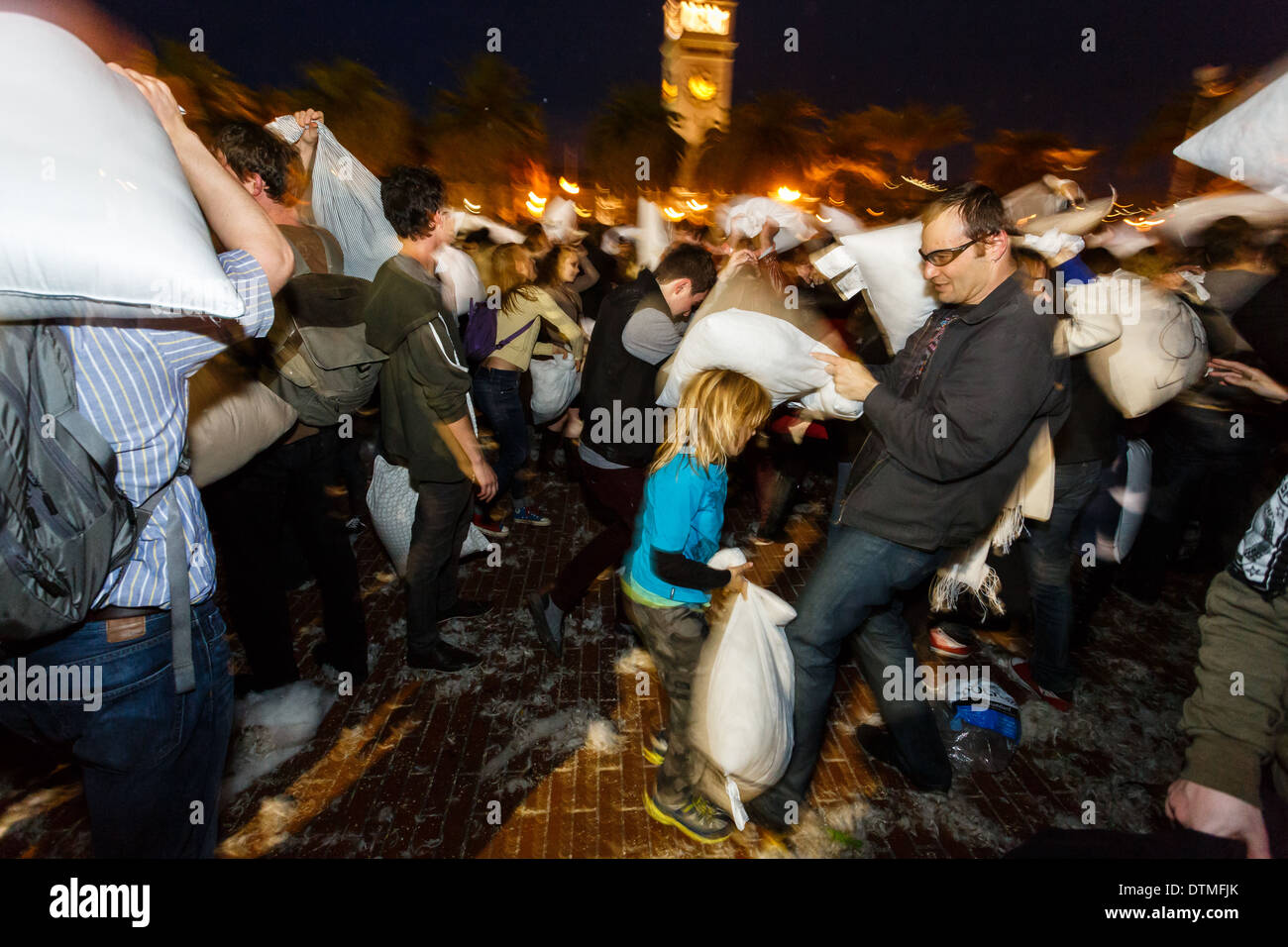 Evasive moves during Valentines Day pillow fight fun in San Francisco - Stock Image