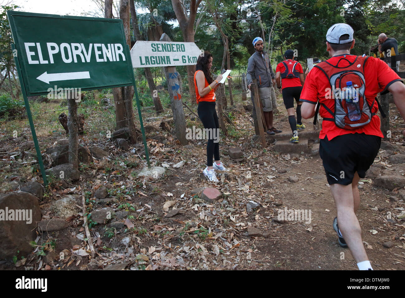 Extreme sports, runners in  25k 'Fuego y Agua' race, check point at the trail head up Maderas Volcano, Ometepe Island, Nicaragua - Stock Image