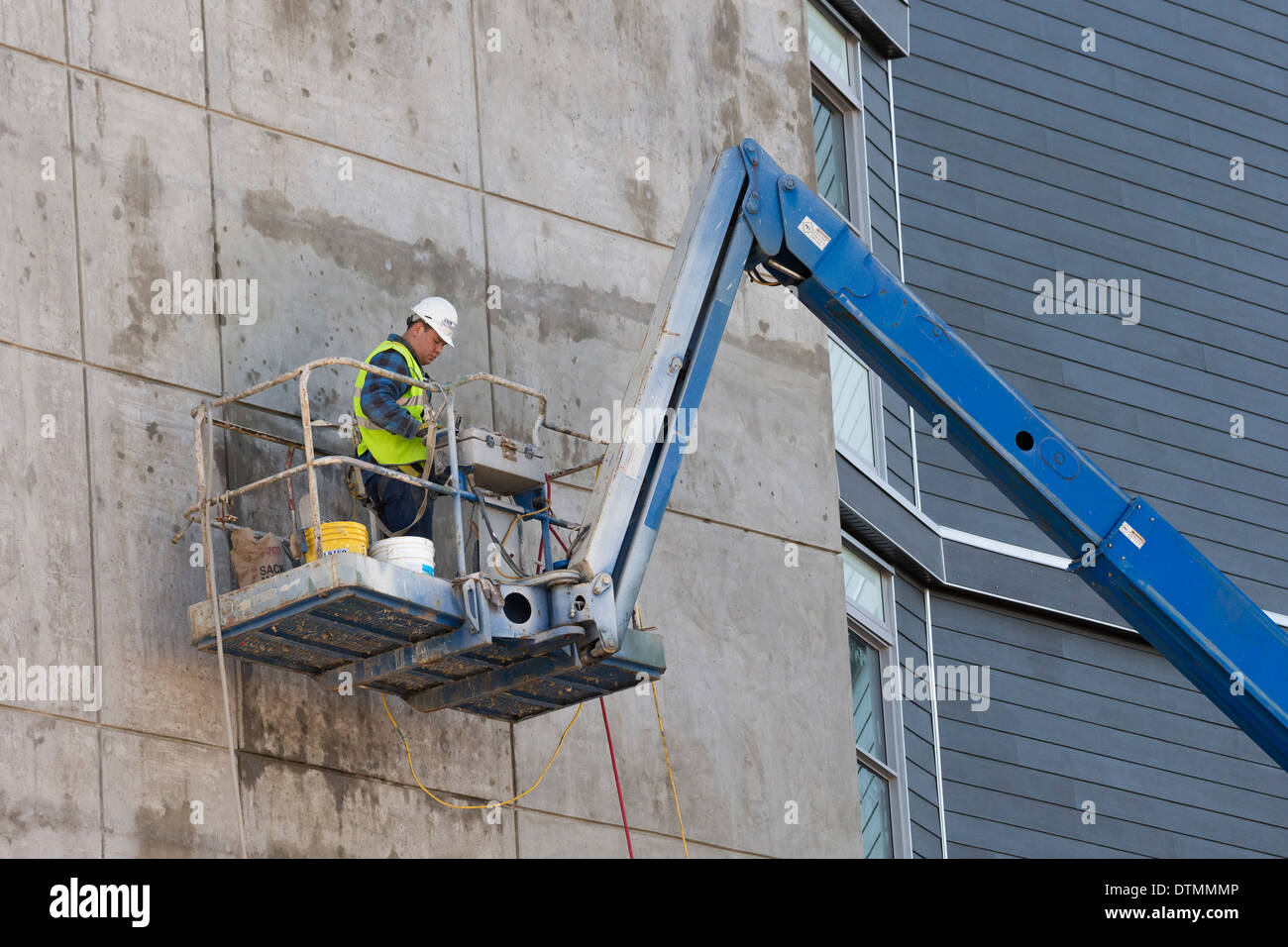 d02812b502b54 Construction worker working on platform on side of concrete building-Victoria