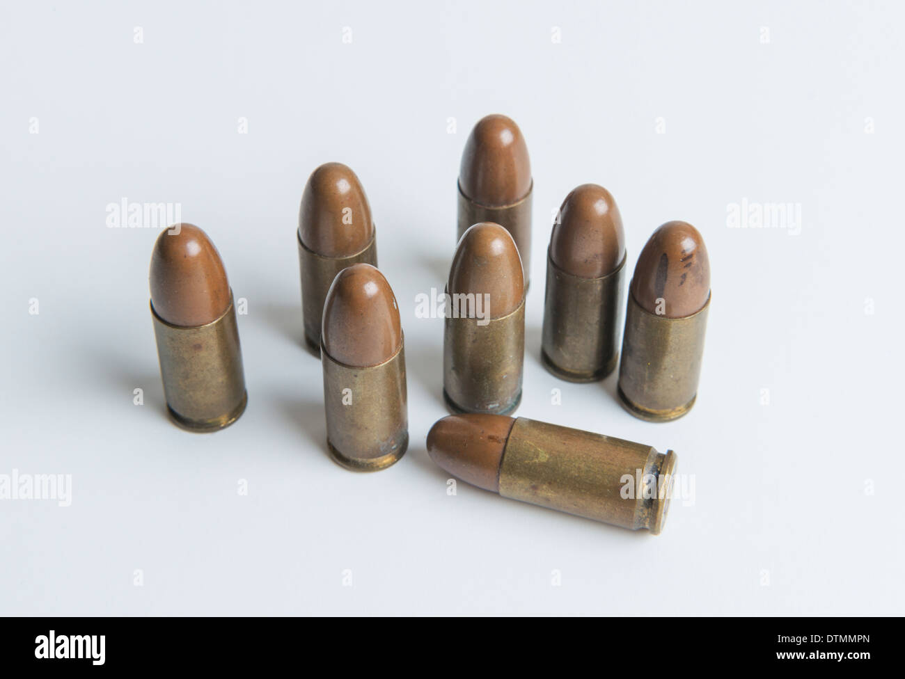 Eight old 9mm bullets from a hand gun. - Stock Image