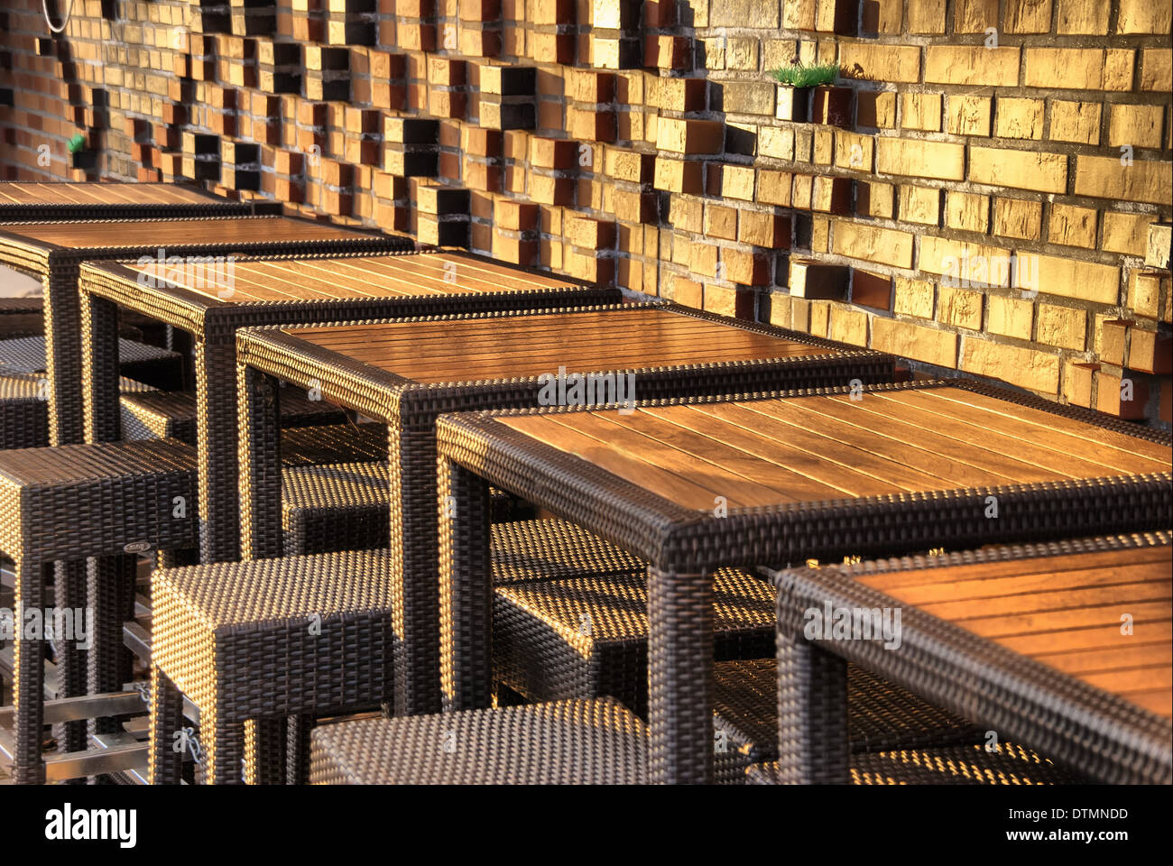 Hafen City stone wall with tables - Stock Image