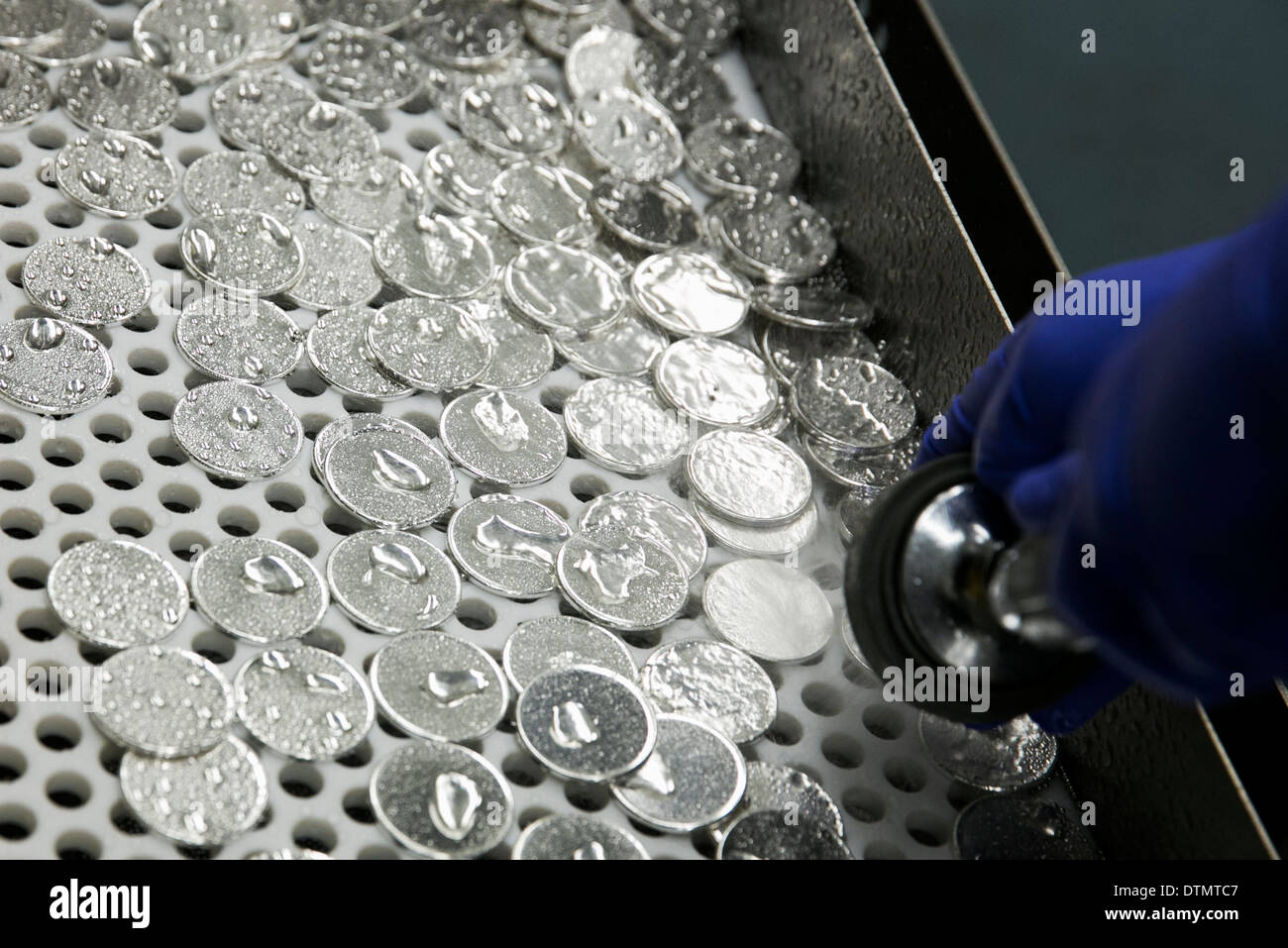 1 ounce Silver Eagle bullion and proof coin production at the West Point Mint. Coin blanks.  - Stock Image