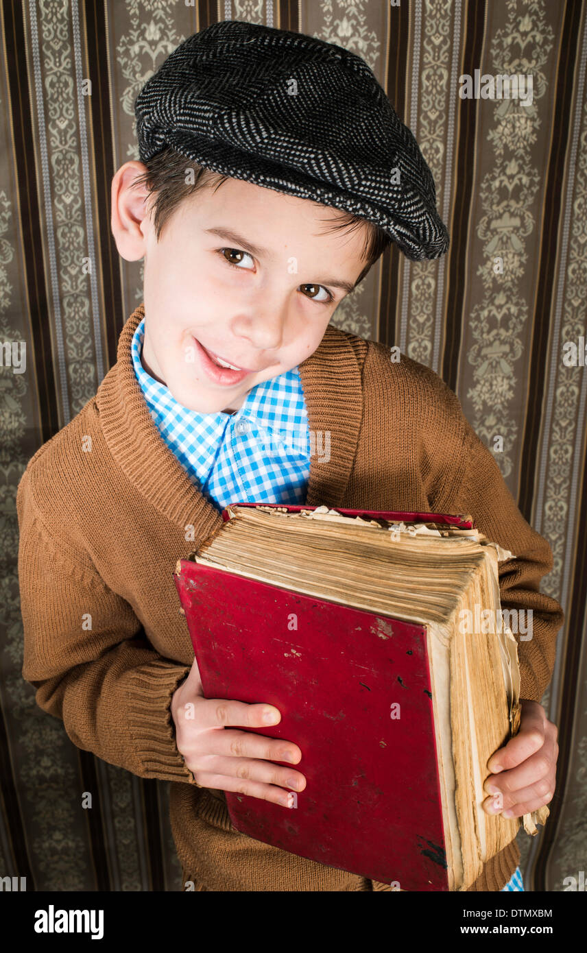 Child with red vintage book. Vintage clothes and hat