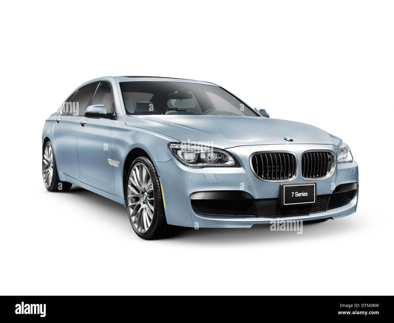 Blue 2014 BMW 750Li XDrive sedan luxury car isolated on white background - Stock Image