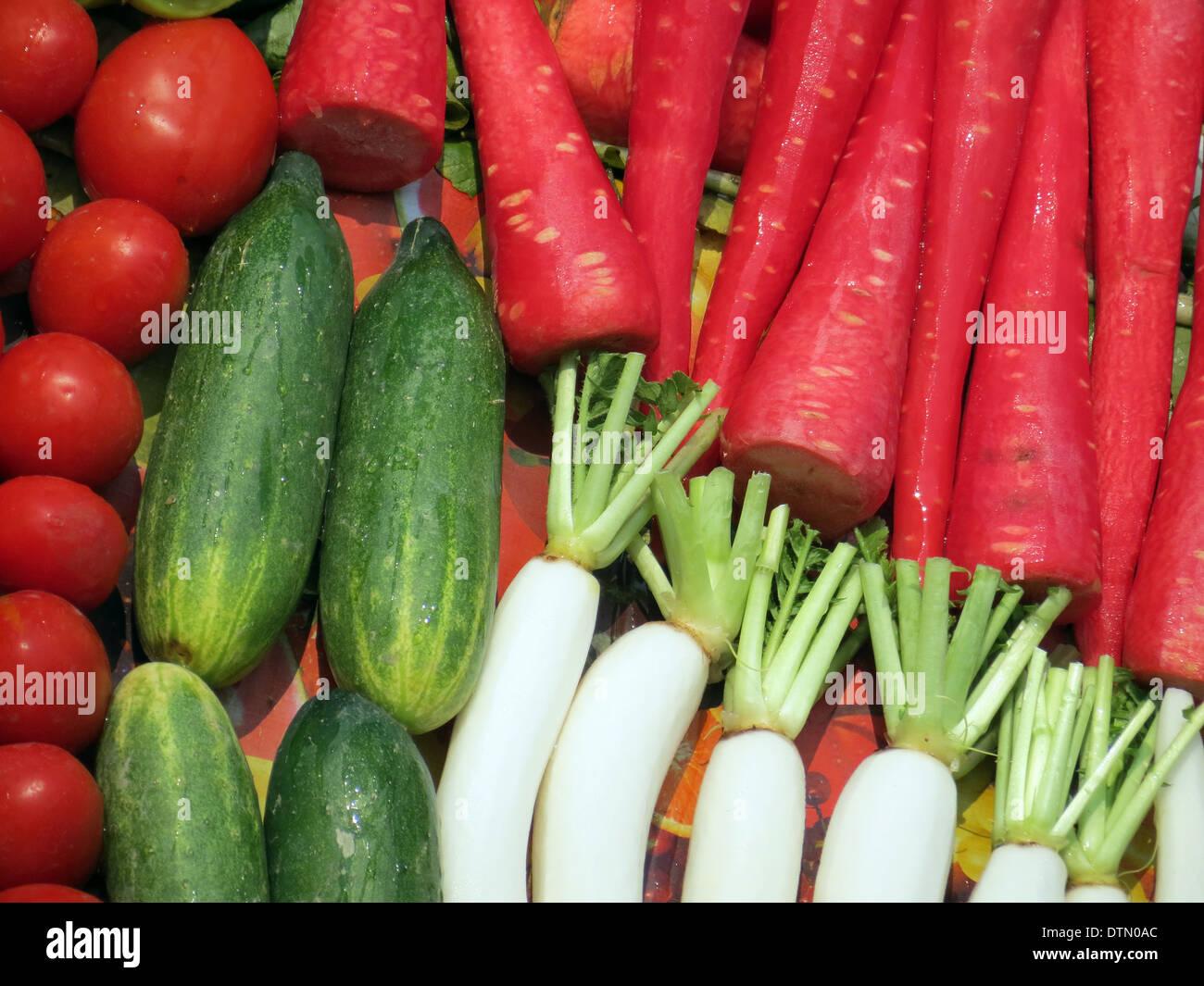 fresh vegetable veggies winter raw food farm tomato carrot radish cucumber - Stock Image