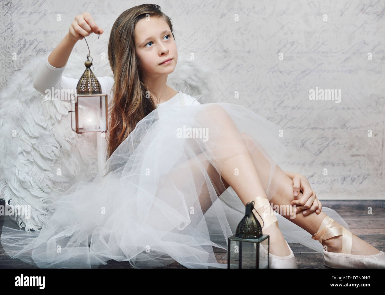 Art photo of young ballet dancer with retro lamp - Stock Image