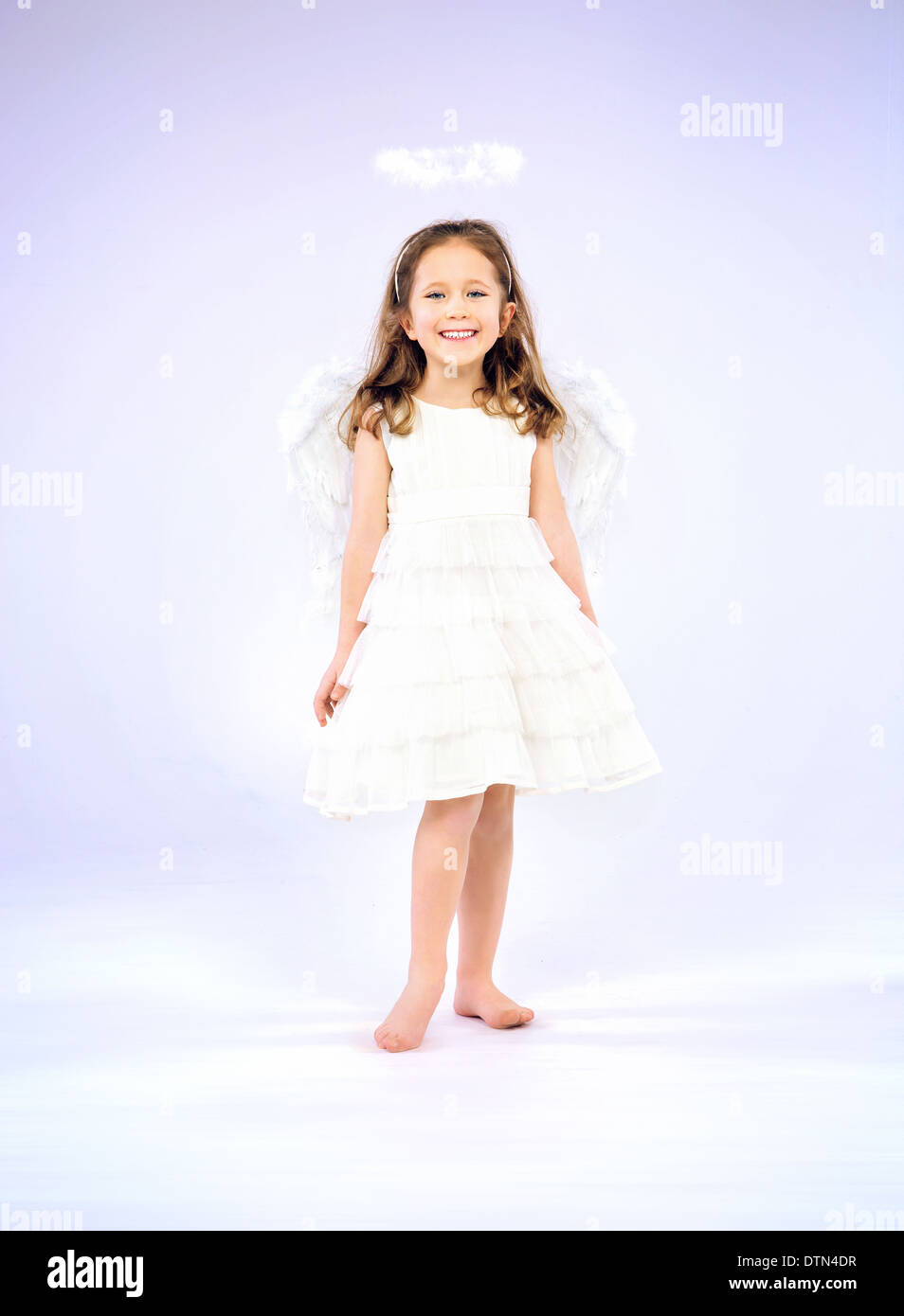 Joyful girl smiling and having fun - Stock Image
