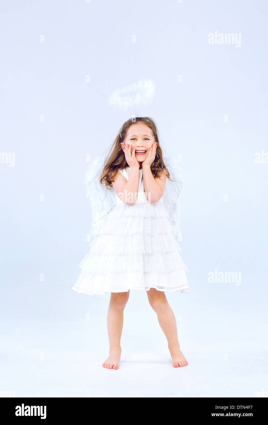 Angel child girl with pure white wings - Stock Image
