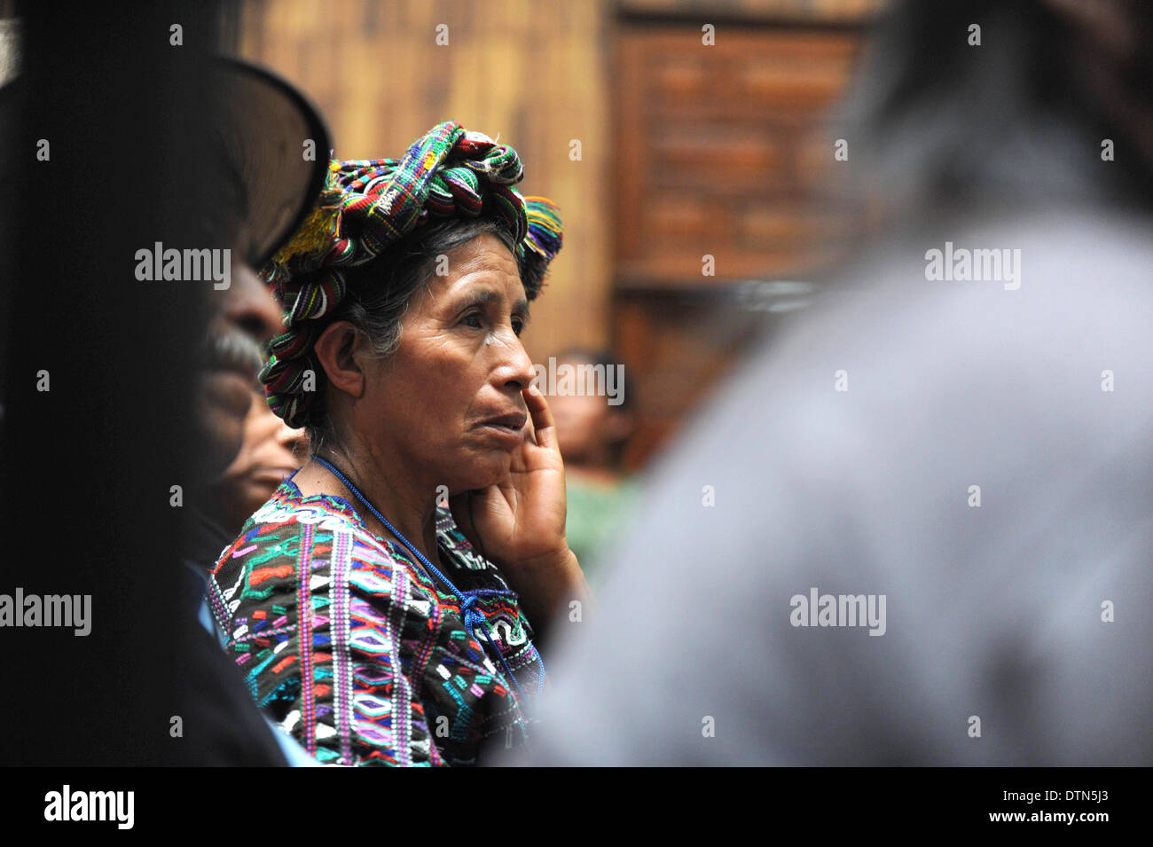 Maya Ixil woman listen to testimony during Genocide trial in the Supreme Court of Justice Guatemala CIty March 19, 2013. - Stock Image