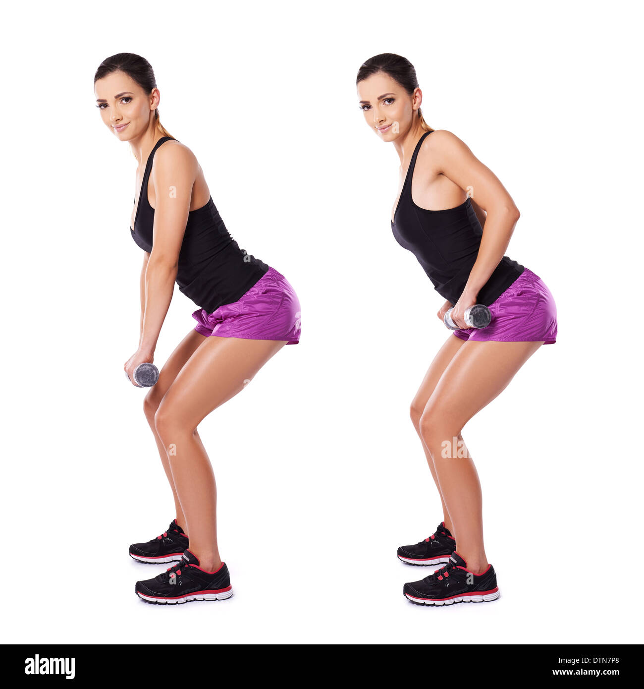 Shapely woman working with dumbbells - Stock Image