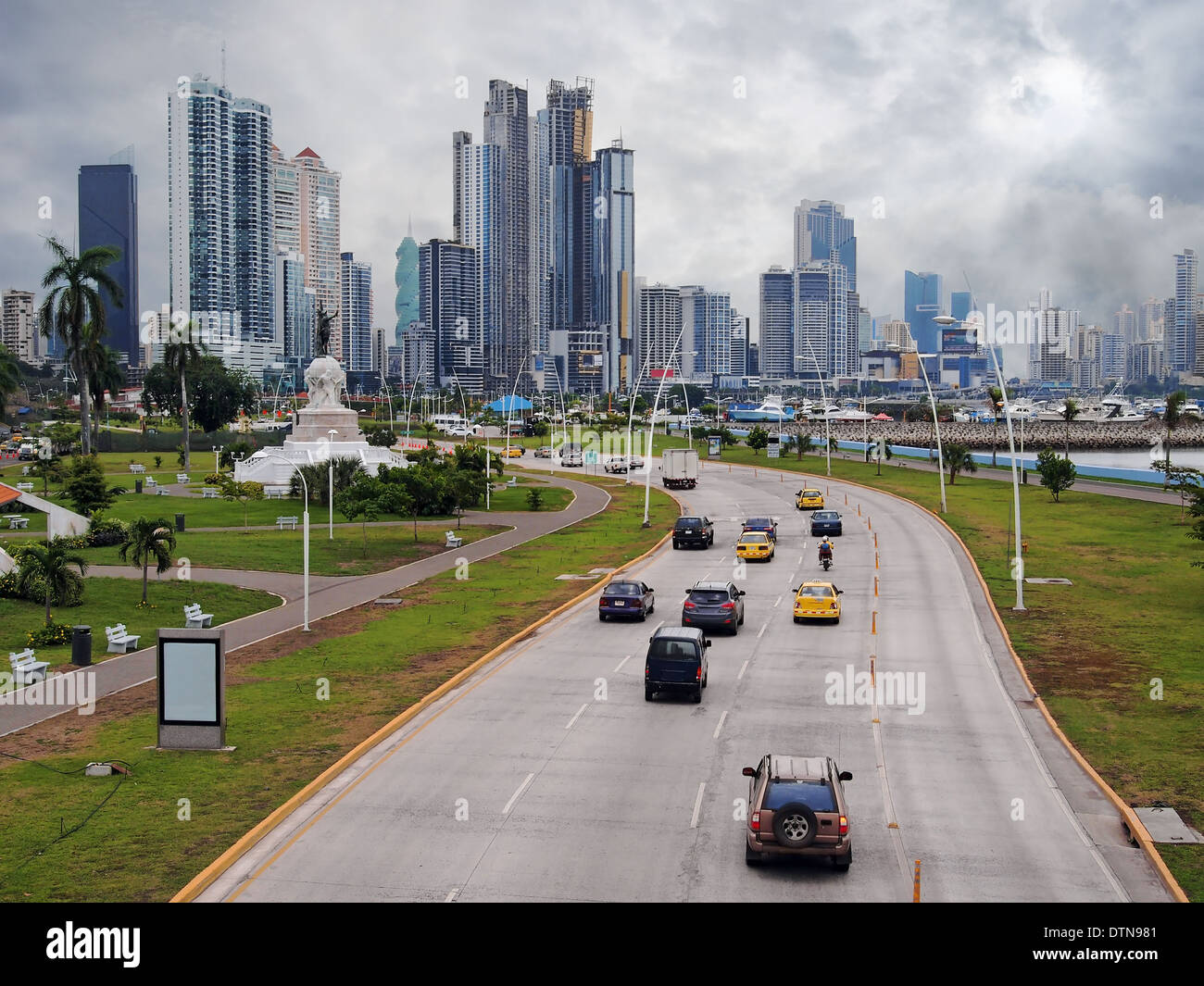 Highway and skyscraper buildings of business center in Panama City with cloudy sky, Panama, Central America - Stock Image