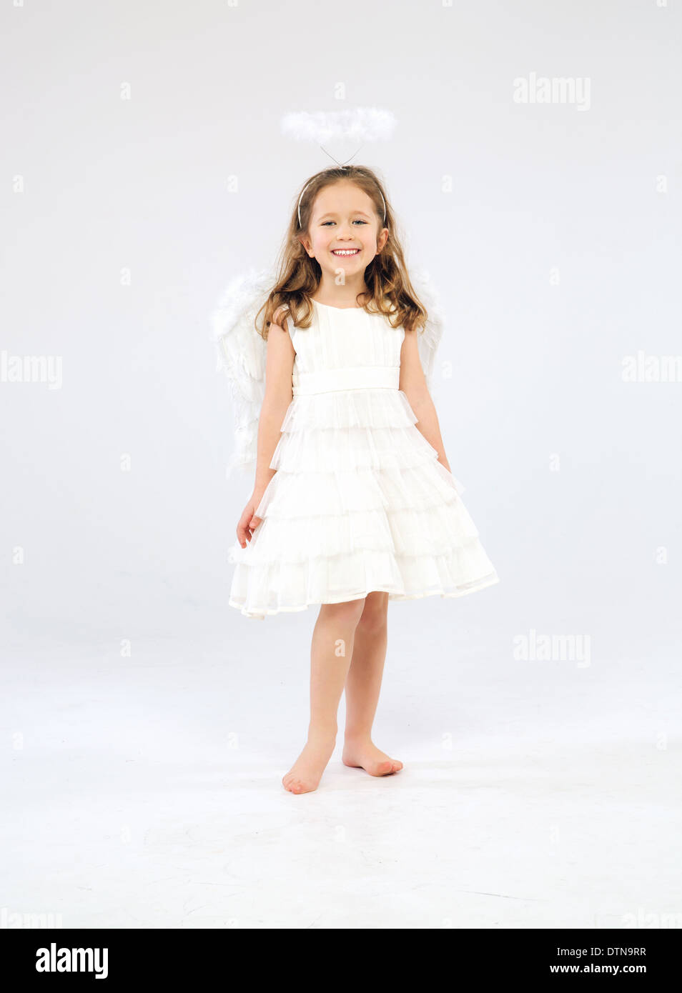Cute little girl as an pure white angel - Stock Image