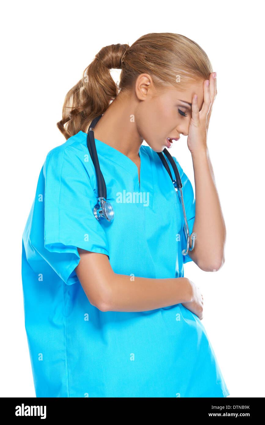 Doctor holding her head in anguish - Stock Image