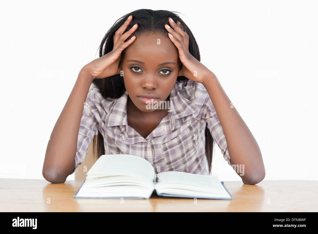 Bored student trying to read a book Stock Photo