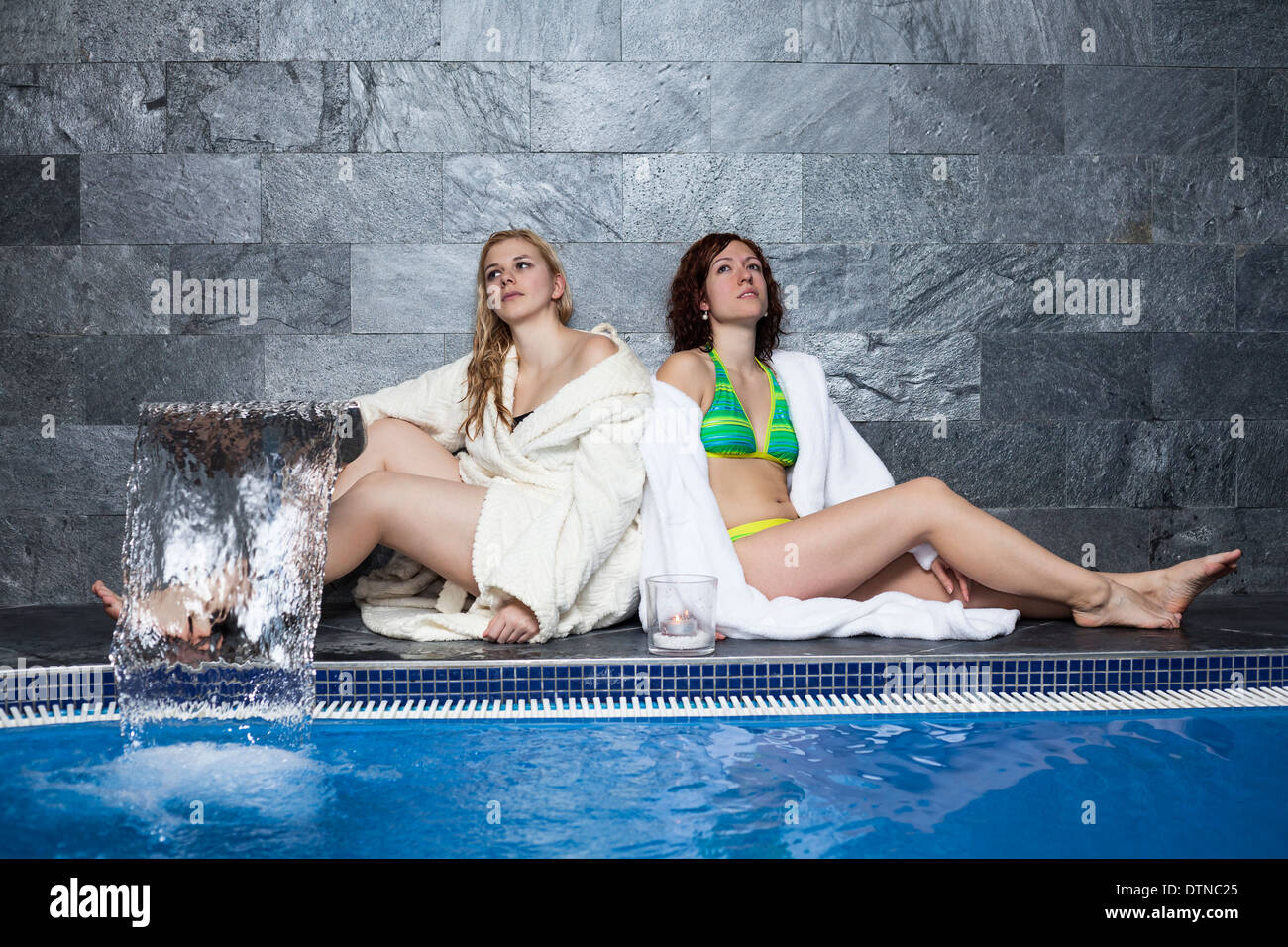 Women relaxing in wellness and spa swimming pool. Stock Photo
