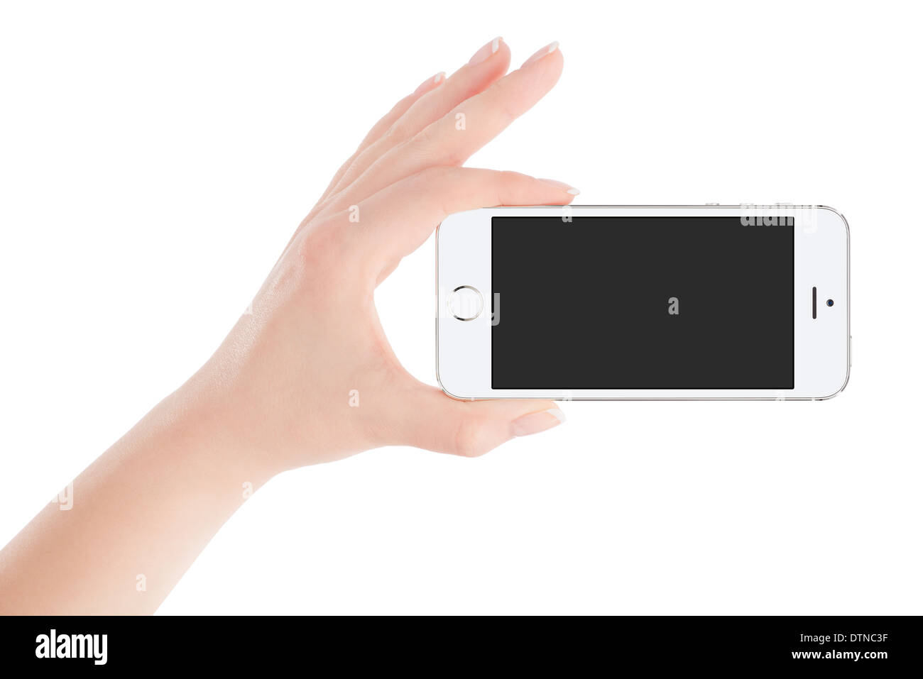 Female hand holding white modern smart phone with blank screen in landscape orientation. Isolated on white background. - Stock Image