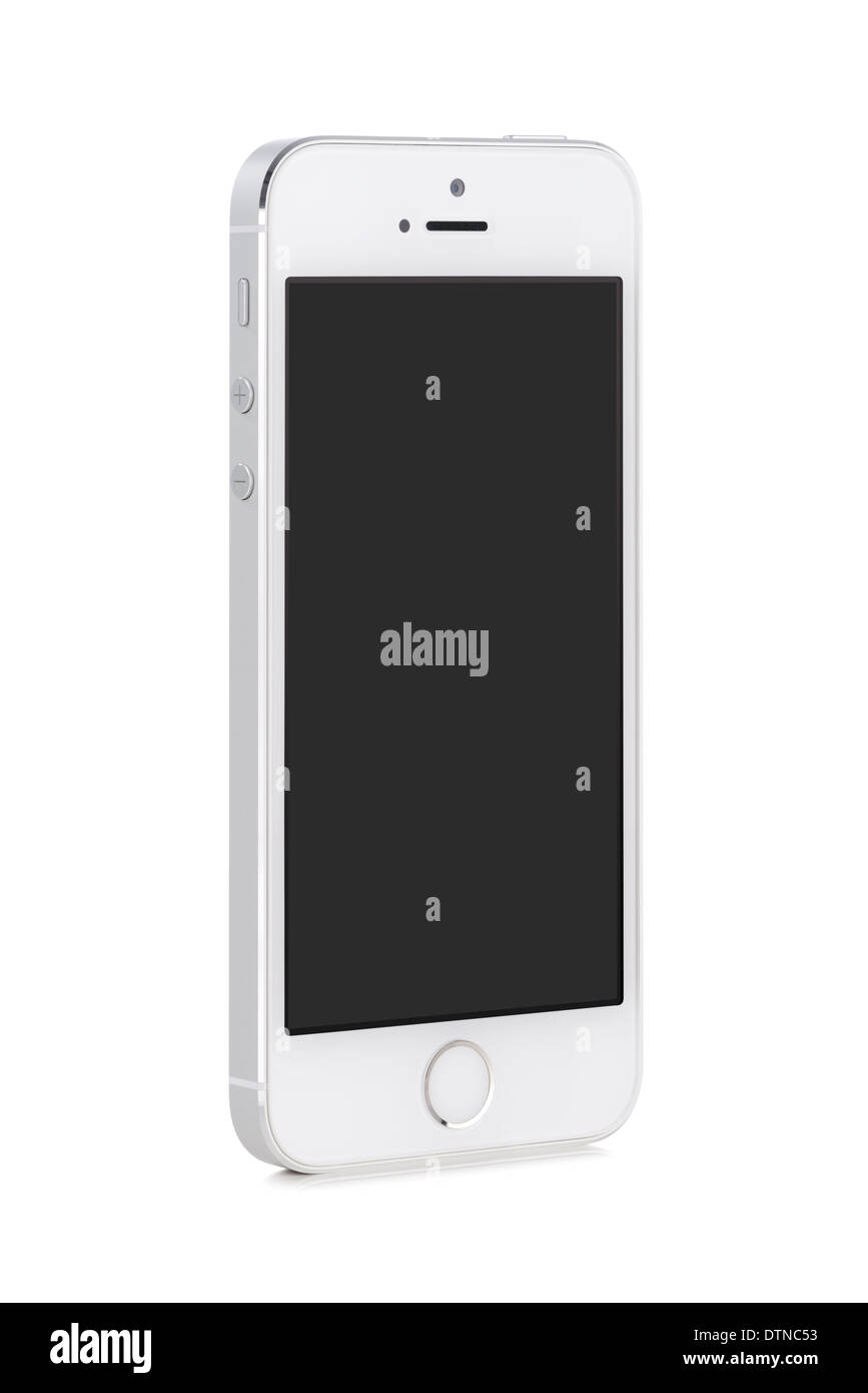 Bottom up view of rotated at a slight angle white modern mobile smart phone with blank screen isolated on white - Stock Image