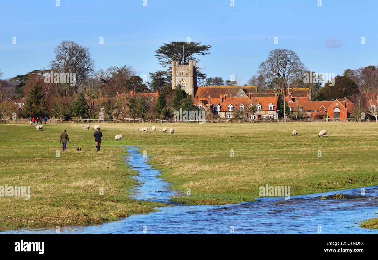 English Rural Hamlet of Hambleden in the Chiltern Hills with grazing Sheep and Dog Walkers Stock Photo