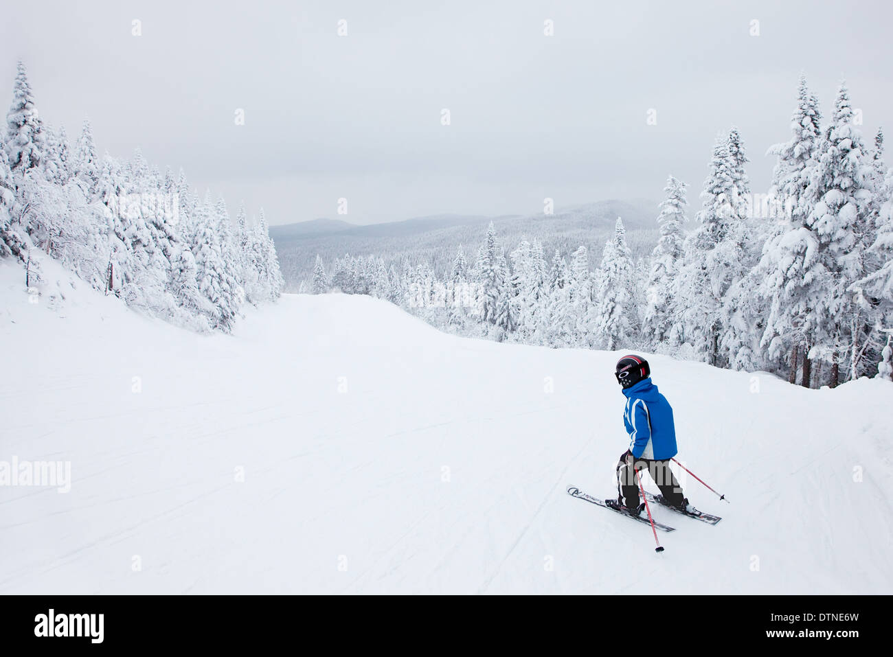 Mont-Tremblant, Canada - February 9, 2014: A boy is skiing down an easy slope at Mont-Tremblant. - Stock Image