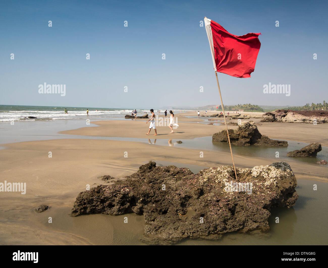 N9159 India, Goa, Ashvem beach, red warning flag indicating unsafe bathing zone - Stock Image