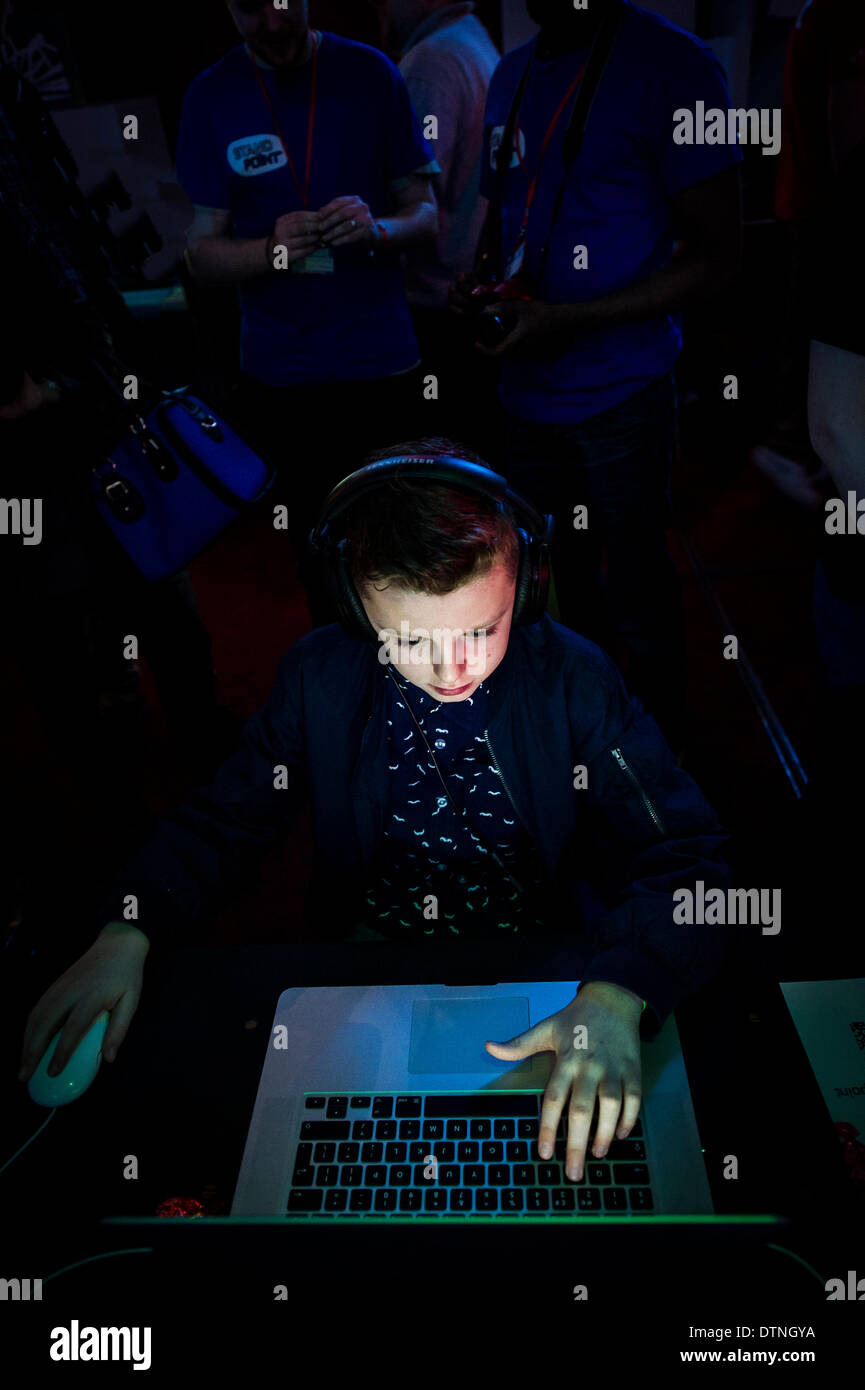 Margate, Kent, UK. 21st February, 2014.  A young gamer intensely concentrates on a game at GEEK 2014, a gaming EXPO in Margate.  Photographer: Gordon Scammell/Alamy Live News - Stock Image