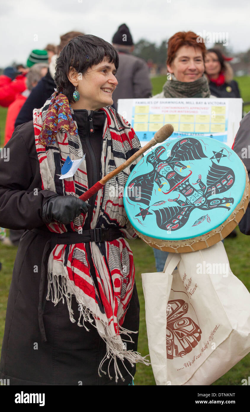 First nations woman beating drum at Idle no More and anti oil pipeline rally-Victoria, British Columbia, Canada. - Stock Image