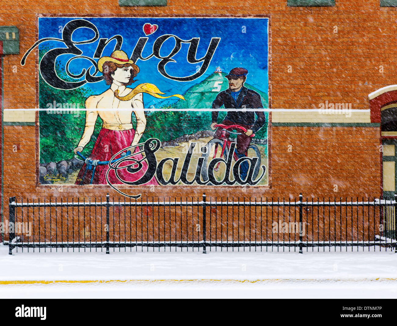 Snowy winter view of colorful mural in historic downtown Salida, Colorado, USA - Stock Image