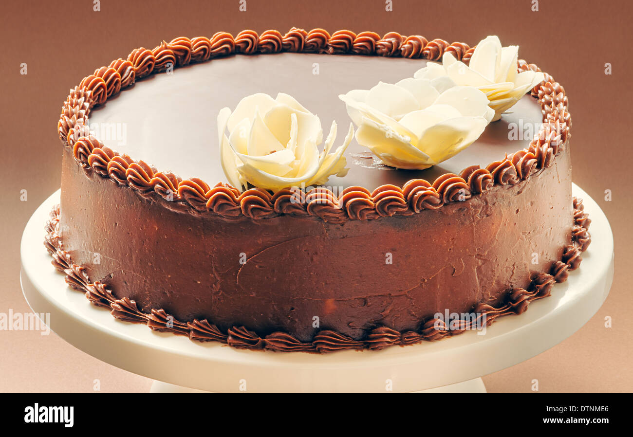 All Chocolate Birthday Cake On Brown Background Decorated With Yellow Flowers Top