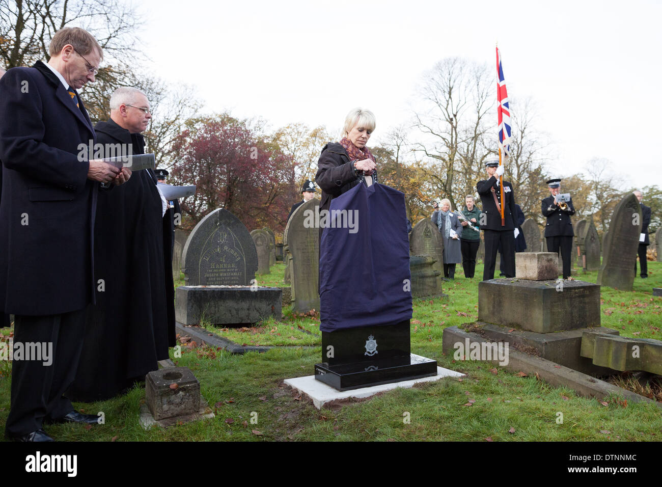 Geraldine Winner unveils the new gravestone marking the grave of PC James Gordon, who was murdered on duty 120 years ago. - Stock Image