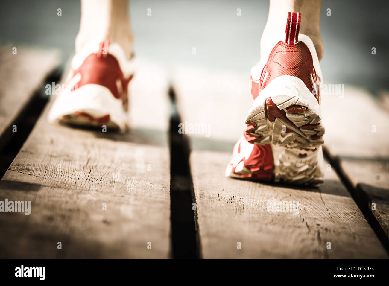 Feet of jogging person - Stock Image
