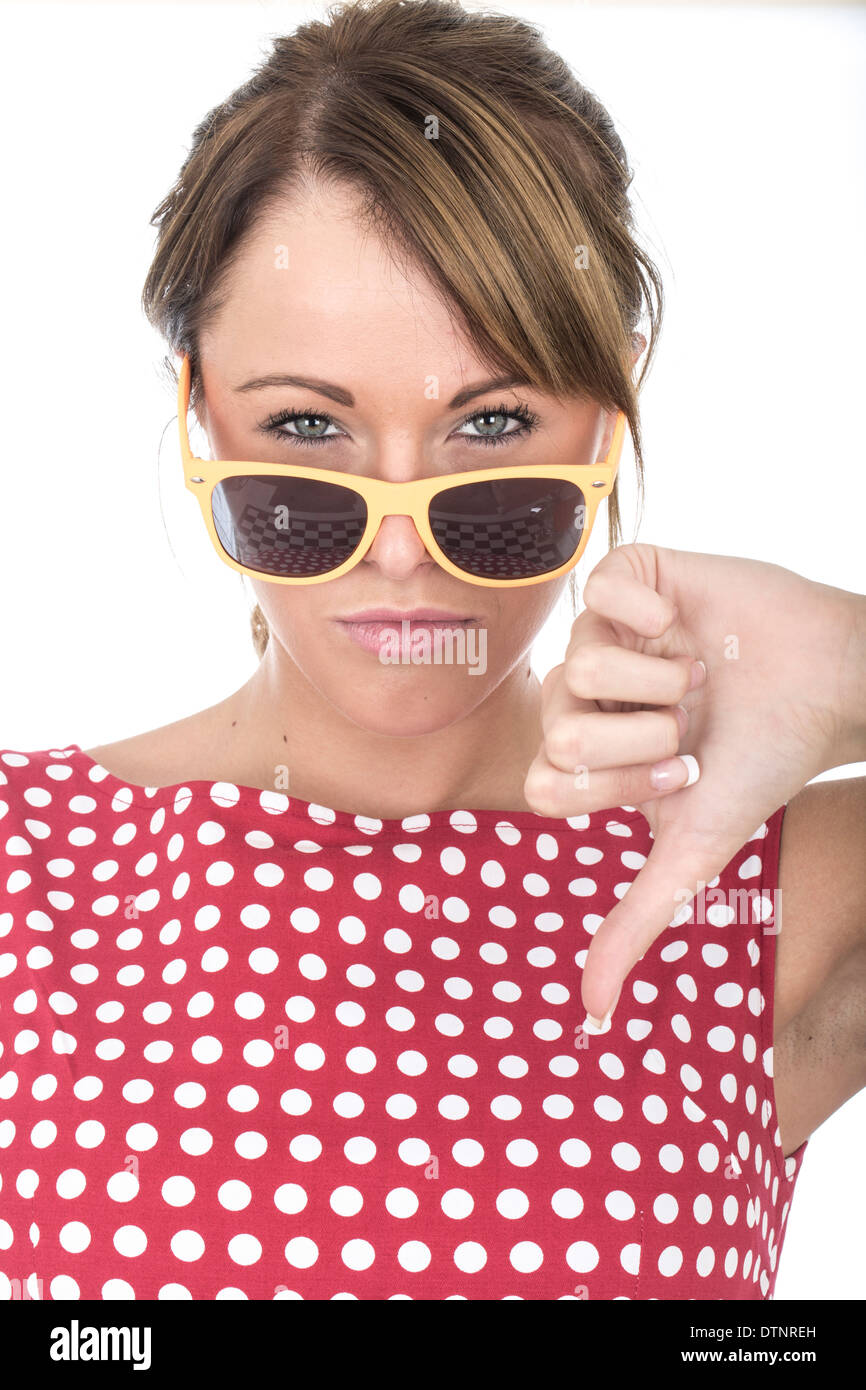 Young Woman Wearing Sun Glasses Thumbs Down - Stock Image