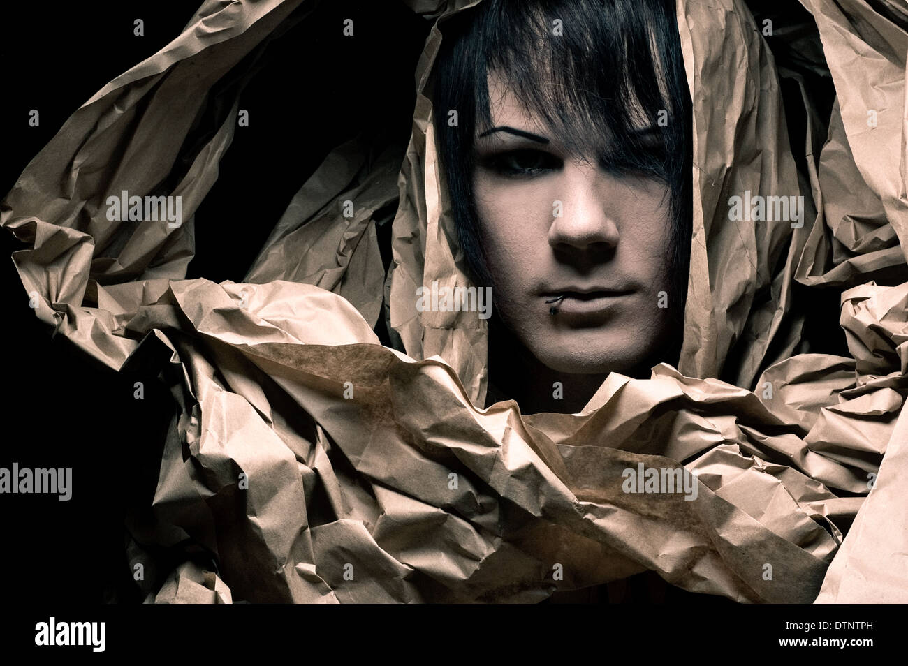 A Male Portrait His Face Is Wrapped With Brown Paper Creative Beauty Concept