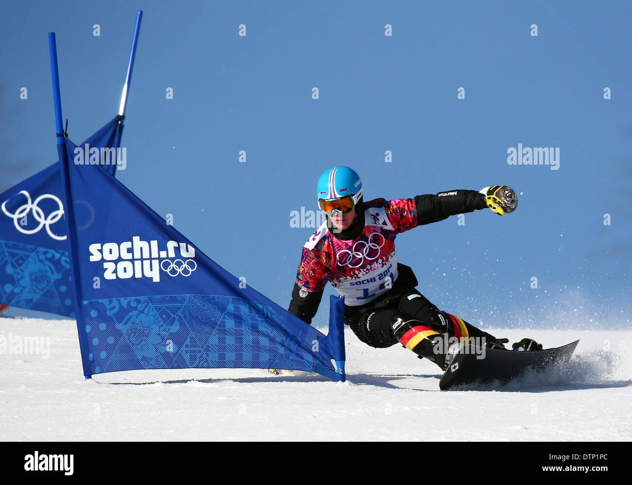Sochi, Russia. 22nd February 2014. Alexander Bergmann of Germany in action during the Men's Snowboard Parallel - Stock Image