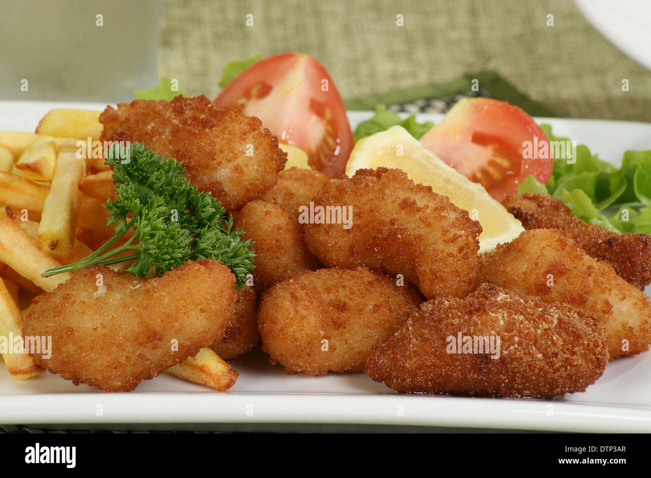 deep fried breaded scampi with fries lettuce and tomato Stock Photo
