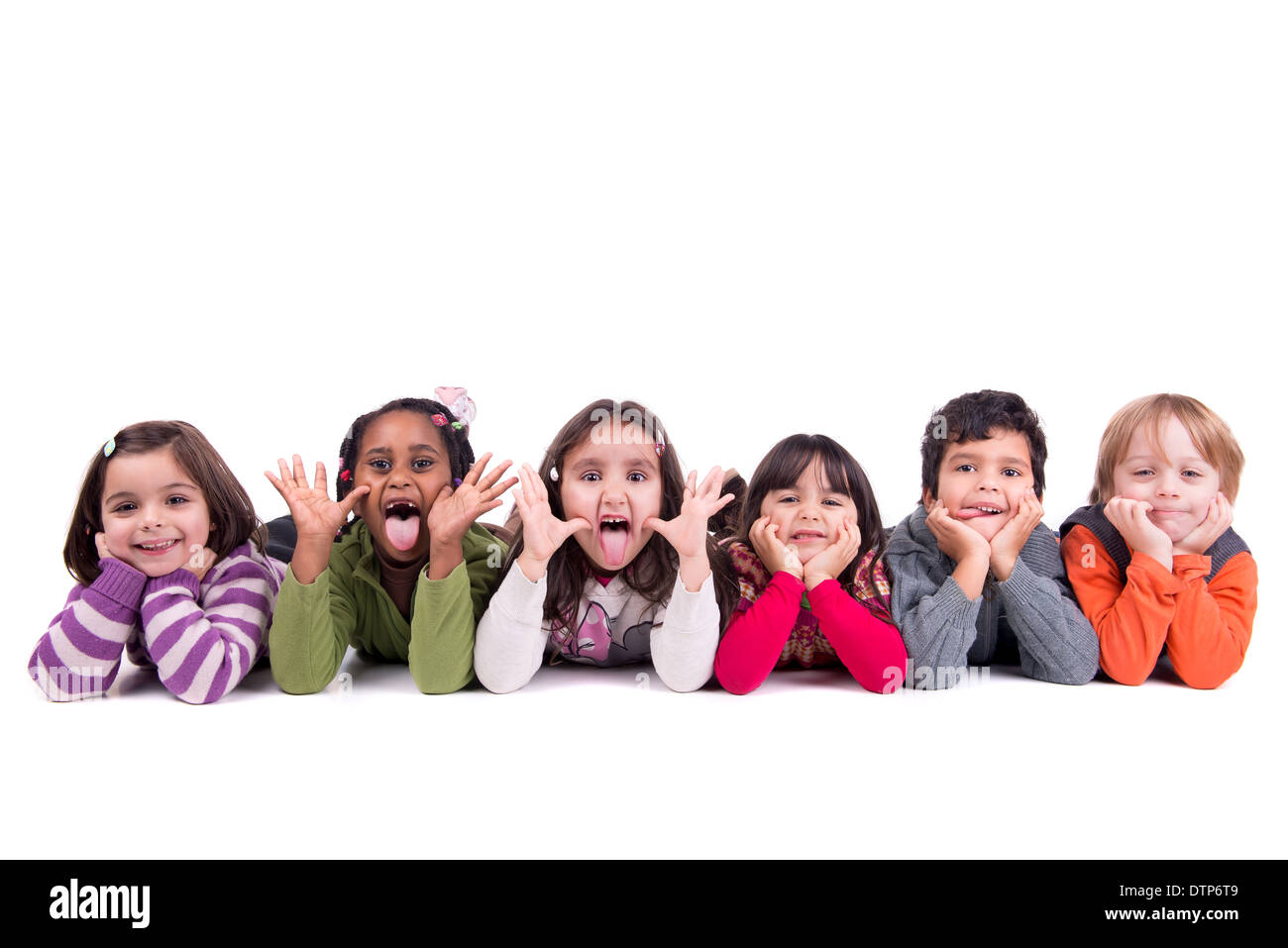 group of children making funny faces isolated in white stock photo