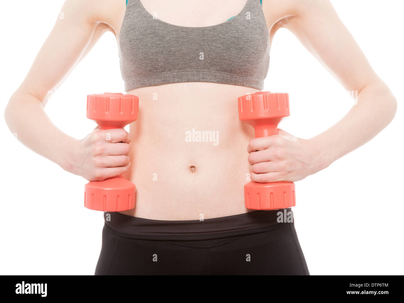 young female working out with barbells - Stock Image