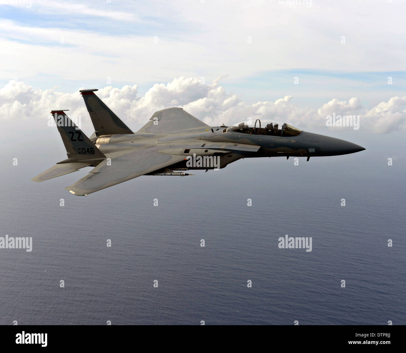 A US Air Force F-15 Eagle fighter aircraft flies over the Pacific Ocean in support of Cope North 2014 February 18, 2014 near Guam. - Stock Image
