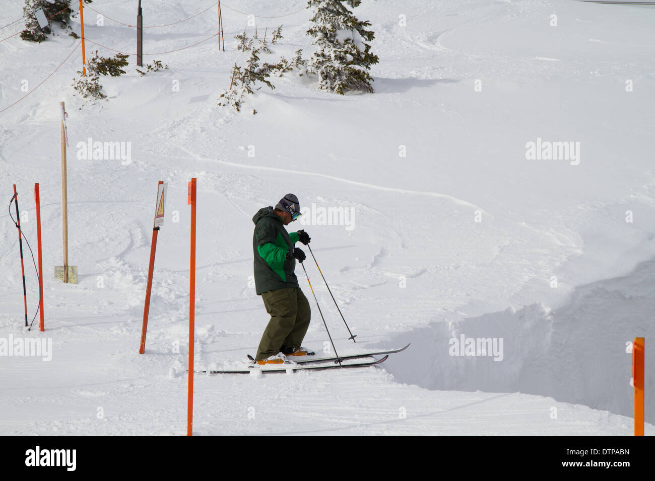 Skier standing at the Edge of Corbet's Coulouir, Jackson Hole, WY - Stock Image