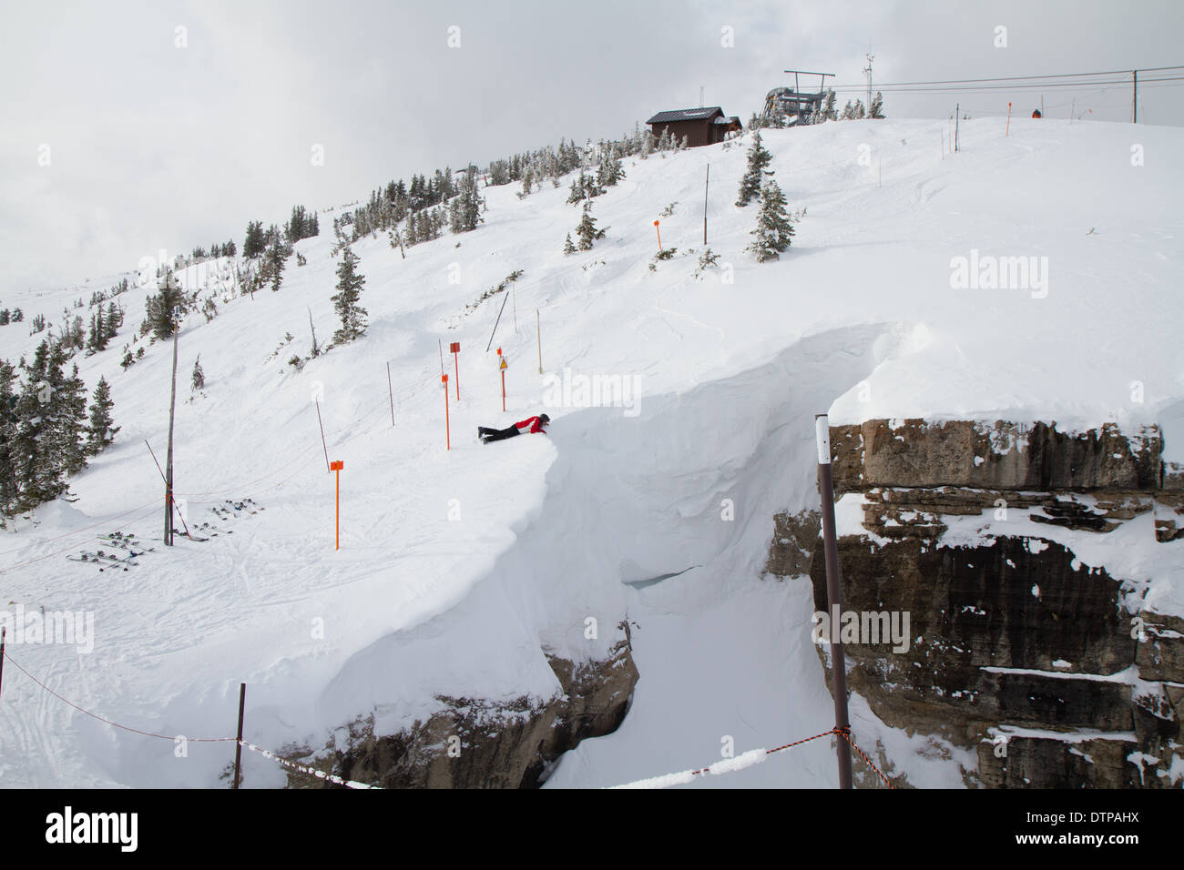 Skiers looking down corbet's couloir, a double black diamond skirun at Jackson Hole, WY - Stock Image