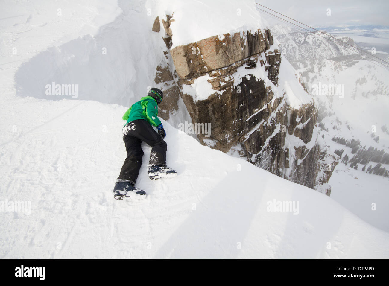 Skiers Looking Down Corbets Couloir A Double Black Diamond Skirun At Jackson Hole WY