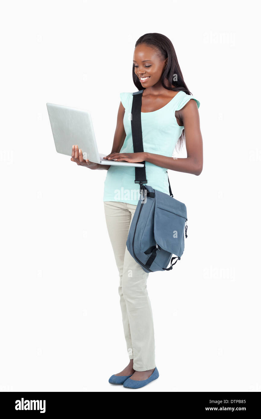 Side view of young student with her laptop - Stock Image