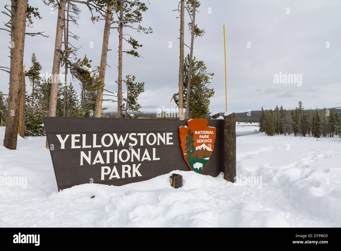Yellowstone national park entrance sign in winter - Stock Image