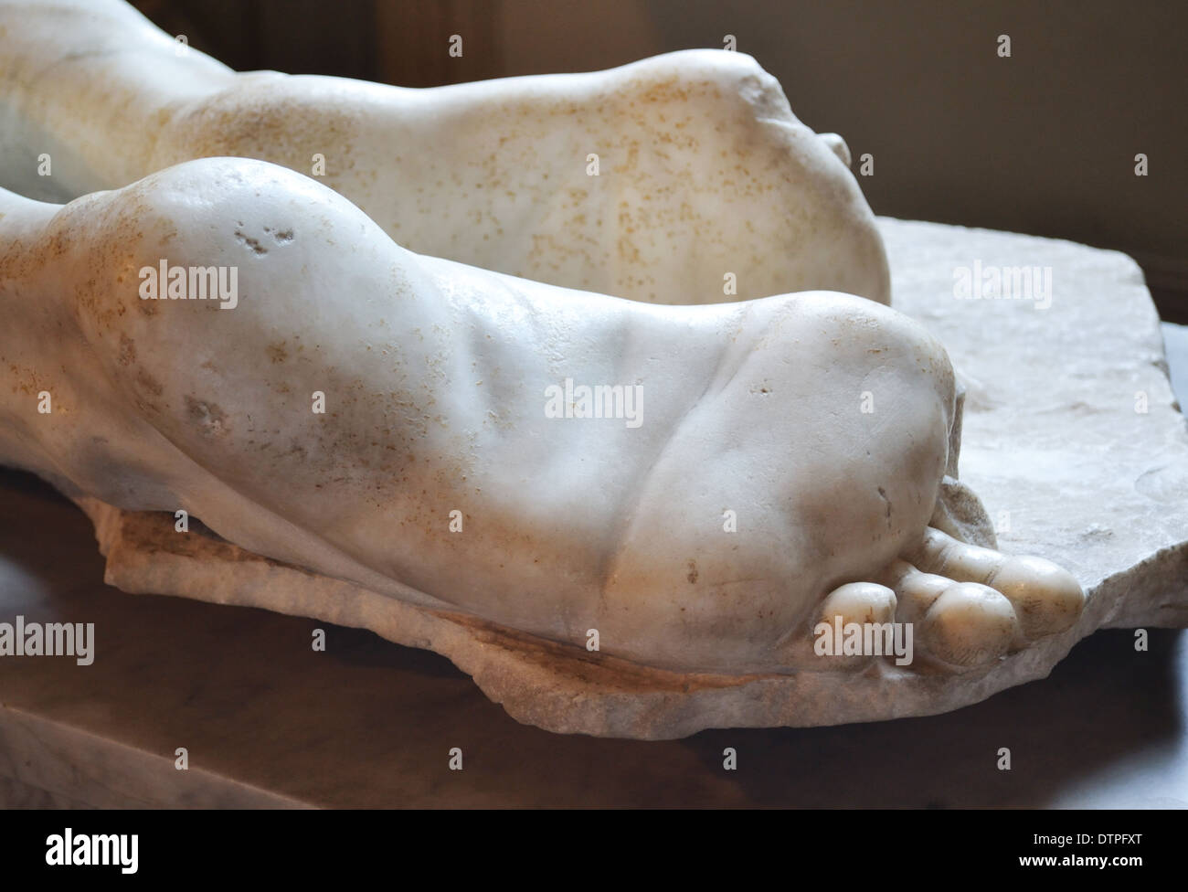 Fragment of an antique statue - foot - Stock Image