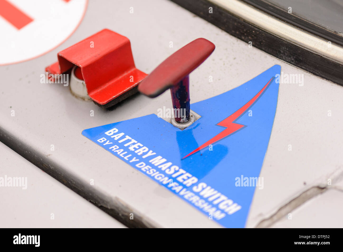 Emergency power cut-off switch and fire extinguisher switch on the outside of a rally car - Stock Image