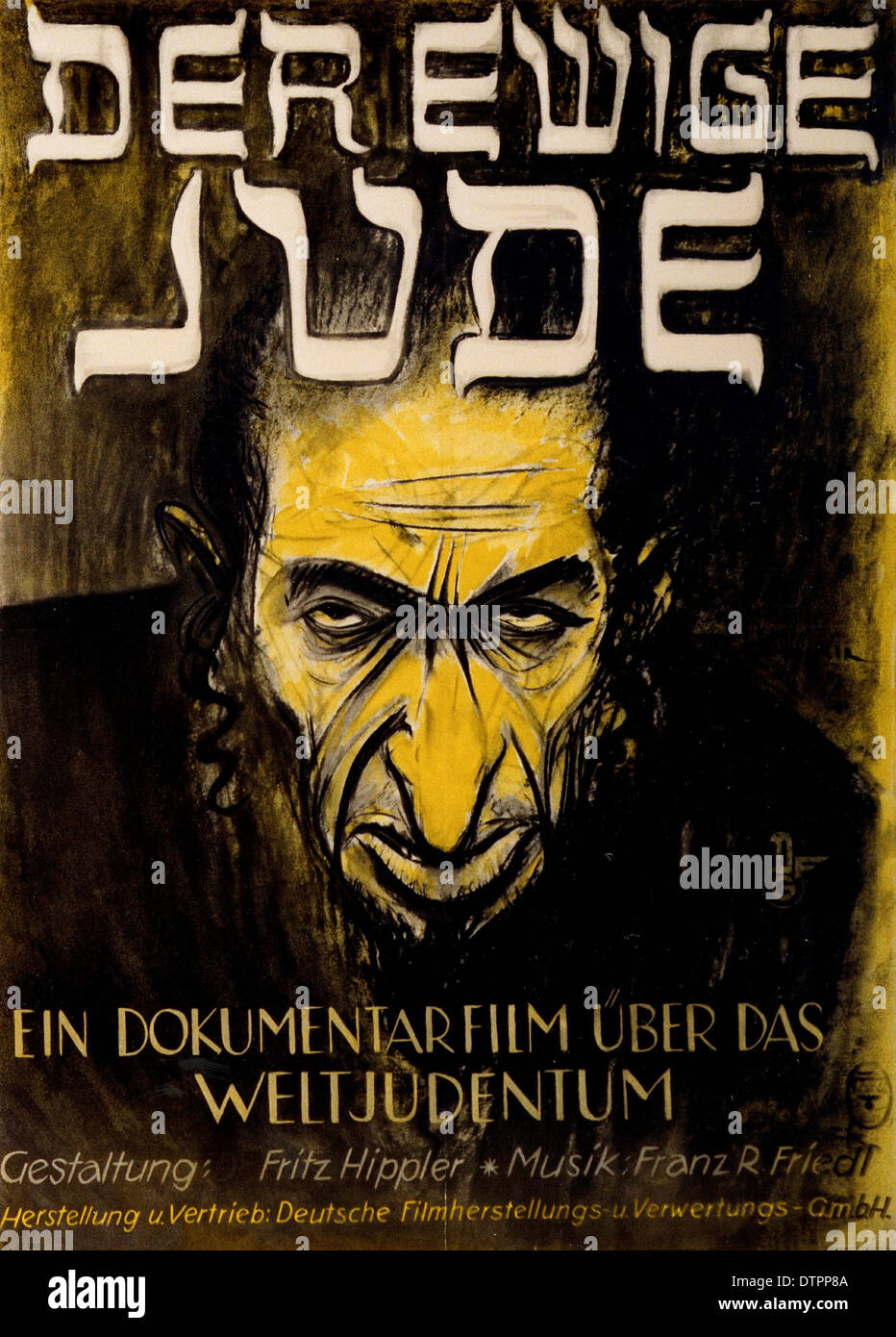 Anti Semitic propaganda poster from the German Nazi regime era in which the Jew is shown as an ugly, angry looking man. - Stock Image